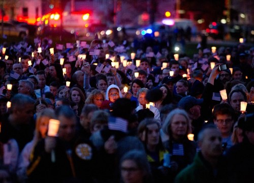 Mourners attend candlelight vigil for Martin Richard at Garvey Park, near Richard's home in the Dorchester section of Boston, on Tuesday, April 16, 2013. Martin is the 8-year-old boy killed in the Boston Marathon bombing. (AP Photo/The New York Times, Josh Haner)